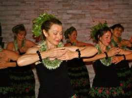 Here she is with some of her hula sisters in a recent hoi'ke (show).